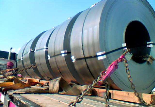 Semi truck hauling metal coils