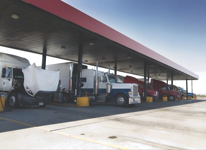 Heavy duty trucks getting fuel