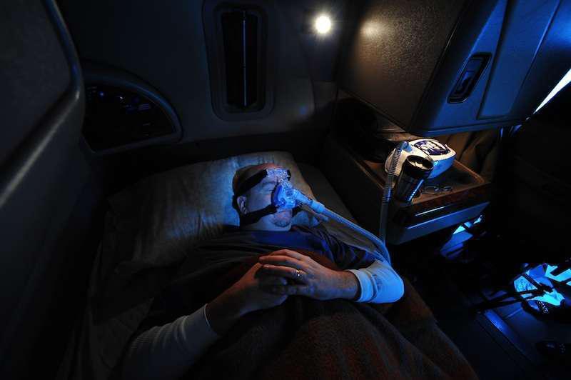Truck Driver Sleeping with Sleep Apnea Mask