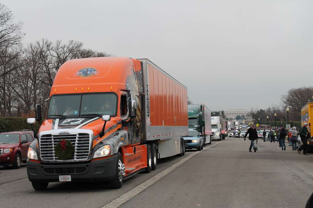 This Schneider National truck was among those in a convoy bearing tens of thousands of wreaths as they arrived at Arlington National Cemetery.