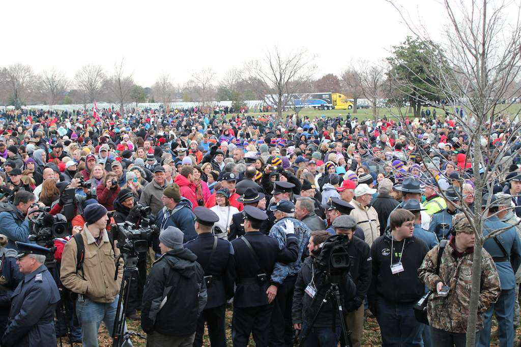 Volunteers gather for the opening ceremony at Arlington National Cemetery. The American Trucking Associations' Share the Road Truck can be seen in the background. This was one of several trucks who participated in a special convoy from Maine to Arlington, stopping at schools, monuments, veterans' homes and communities along the way.