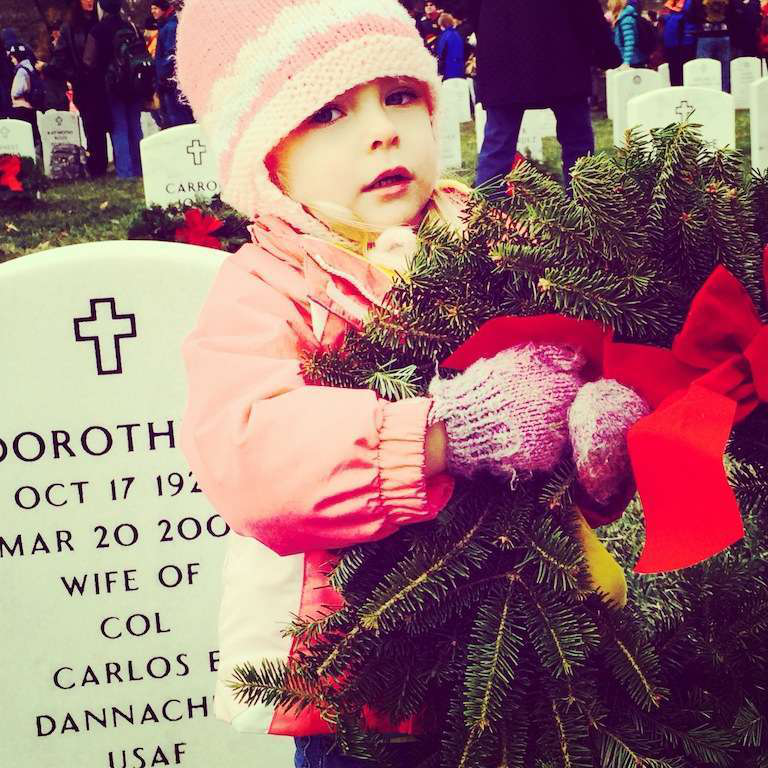 Volunteers ranged from uniformed service members and gray-haired veterans to the young girl pictured here. Teaching our children the value of freedom is a core part of Wreaths Across America's mission.