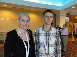 Milana Yuriychuck (left) and Paul Ilin attend the Sylectus user conference to grow their family-owned expedite business, Storm Logistics