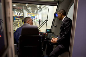 President Obama gets an inside look at a light-rail commuter train in St. Paul, Minn., Wednesday, before announcing a new round of TIGER grants. (White House photo)