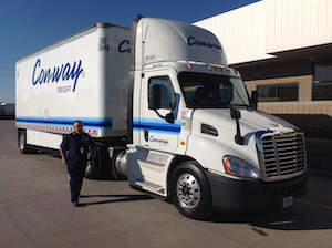 Jack Malloy, driver trainer at Con-way, conducts a pre-trip inspection