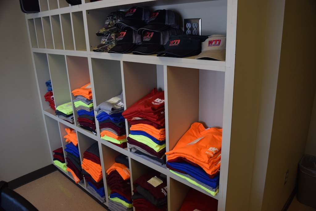 Last, drivers can grab plenty of complimentary WTI gear from a smaller driver lounge within WTI's office.