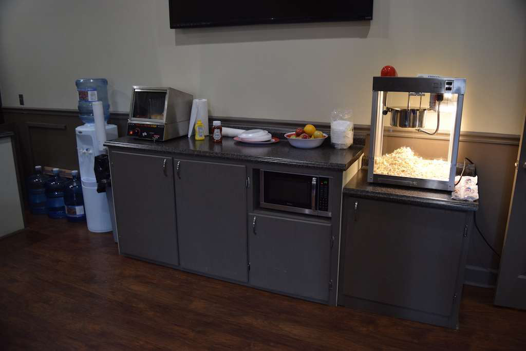 WTI included two refreshment stations in the driver lounge, complete with a popcorn maker, hot dog machine, microwave and more. Another not pictured here features a soda fountain.