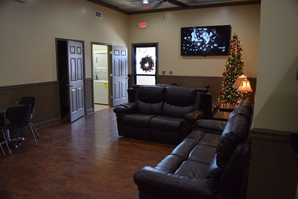 Several leather, plush couches anchor the driver lounge, and two 70-inch TVs flank both sides of the lounge's main room.