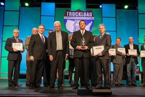 Paramount Freight Systems director Trent Dye accepts the Best Fleets to Drive For award in the owner-operator category at the Truckload Carriers Association's annual convention in March in Grapevine, Texas.