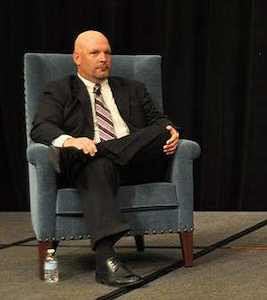 David Heller speaking earlier this year on a panel discussion at the CCJ Spring Symposium.