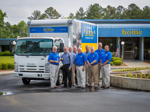 Isuzu Commercial Truck of America reached the 500,000 trucks sold milestone with the sale of this truck to Farmers Home Furniture in Dublin, Ga.