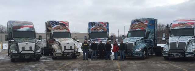 CTS is honoring military veterans with trucks wrapped to honor each branch of the U.S. military. Shown are CTS veteran drivers and the wrapped trucks.