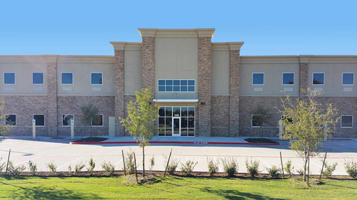 The KLLM Driving Academy in Lancaster, Texas, is a new two-story 44,000-square-foot school with modern classrooms and a residence hall.