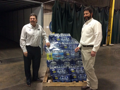 Kevin Burch, crop on shorter dude with his left hand on water] Kevin Burch, president of Jet Express, sparked an initiative that has delivered 340,000 bottles of fresh water to Flint, Mich.