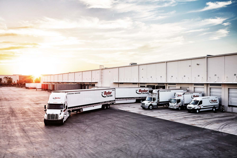 Ryder semi-trucks docked at a warehouse