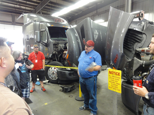 Rick Drigmore, shop manager of Pride Transport, explains the fleet's maintenance procedures to new drivers on Wed., May 4.