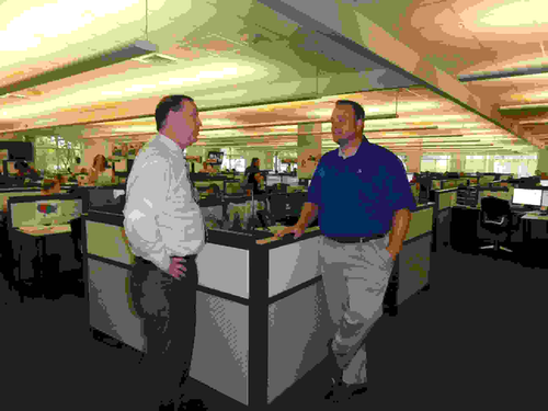 Richard Cribbs, CFO, and Doug Schrier, VP of continuous improvement, on the operations floor of CTG in Chattanooga, Tenn.