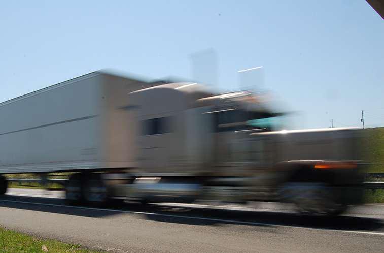 Truck Driver Speeding By on Interstate