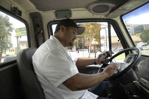 Truck driver in cab of his truck