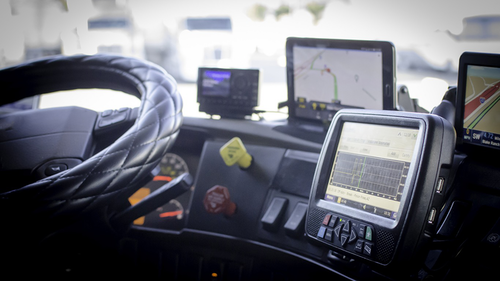 Electronic logging device in the cab of a truck