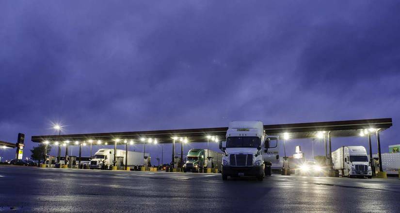Semi trucks parked at a truck stop