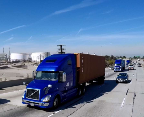 Three Volvo VNL 670 tractors driving on the road