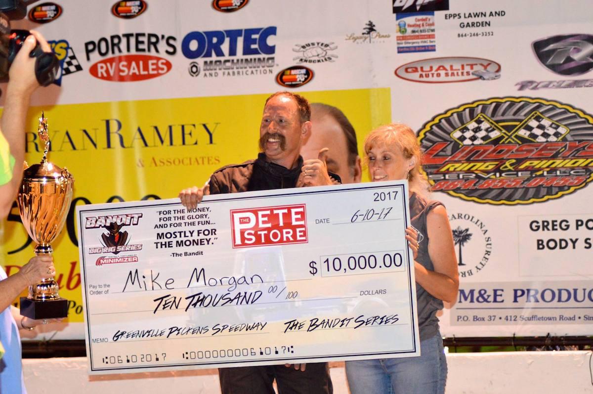 Mike Morgan with awards check
