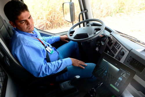 Man Sitting in Cab of Truck