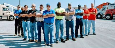 Picture of Several Company Drivers in Parking Lot