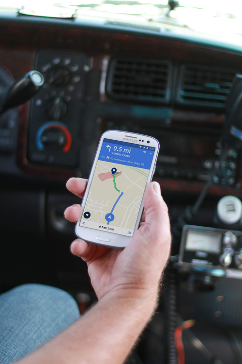 Trucker looking at map on smartphone