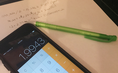 Calculator on a smartphone with pencil and paper