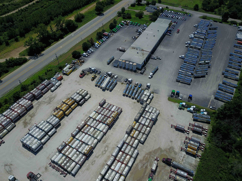 Overhead view of trucks at facility