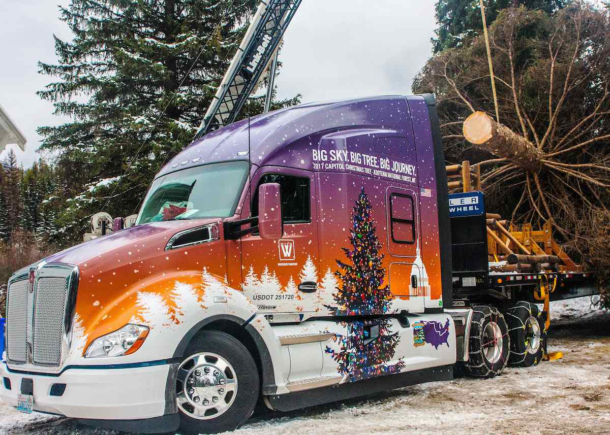 Custom-wrapped Christmas themed Kenworth T680 Advantage semi truck