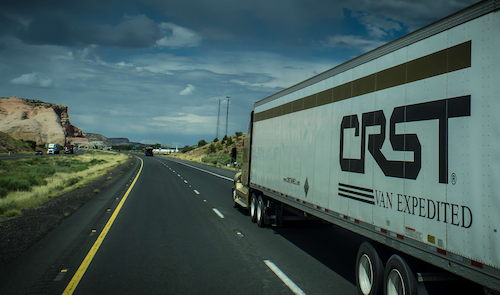 CRST Expedited semi truck on the road
