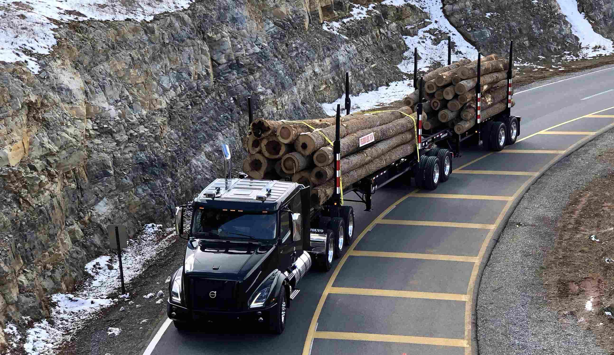 Volvo VNX semi truck hauling logs
