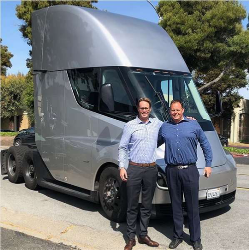 TCI Co-President's, Andrew & Ryan Flynn in front of a Tesla Semi