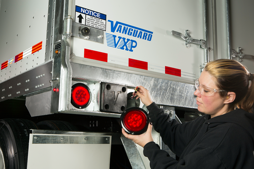 Mechanic checking trailer lights