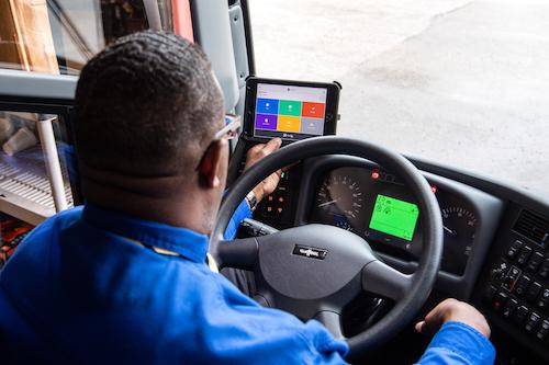 Truck driver reviewing Samsara Driver Efficiency Report