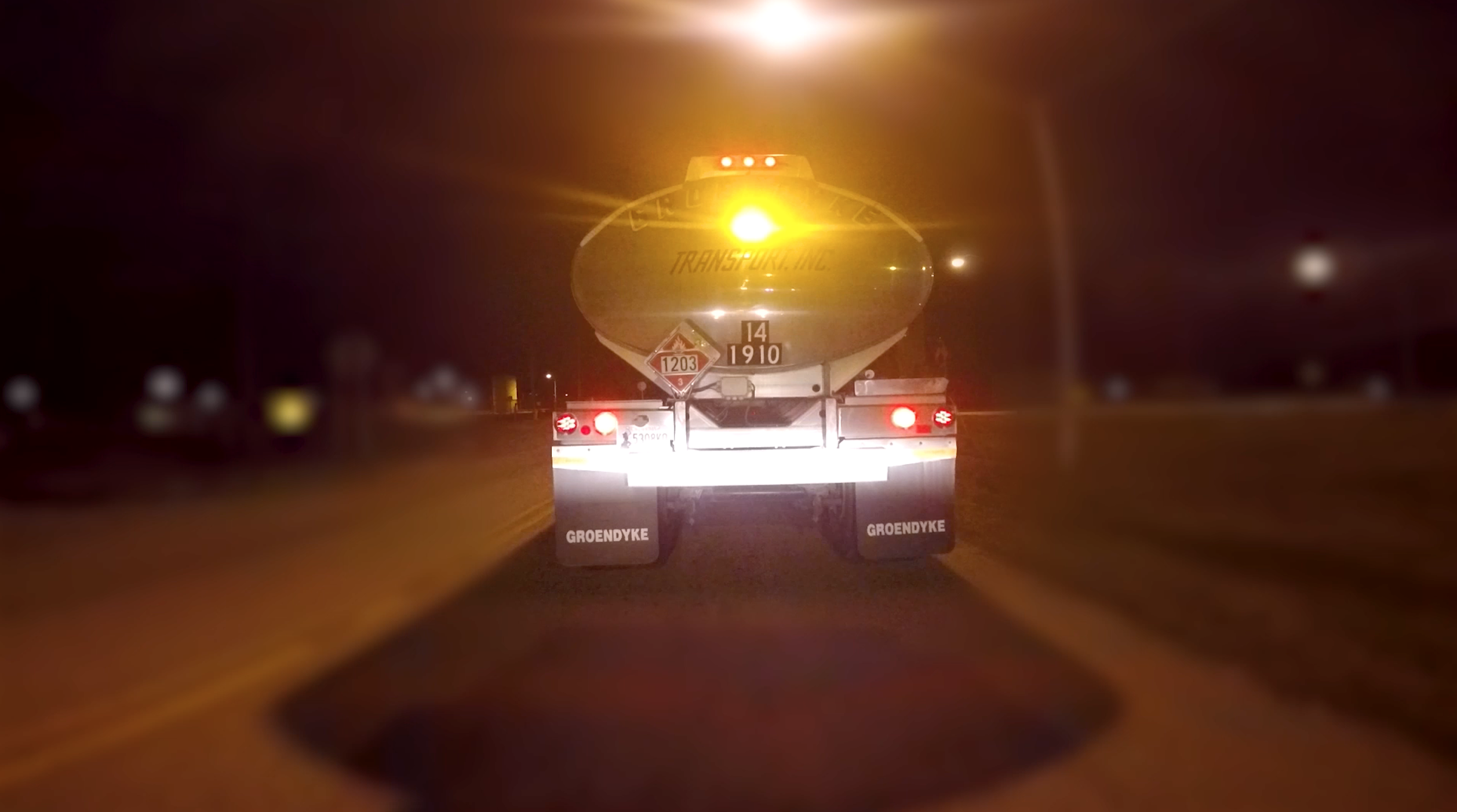 groendyke transport tanker featuring pulsating brake light at night
