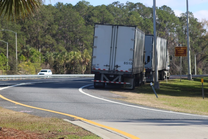 semi trucks pulled over on the side of the road