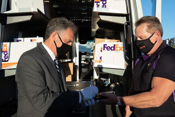 FedEx Express driver delivering package