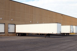 Semi-truck trailers parked at a warehouse