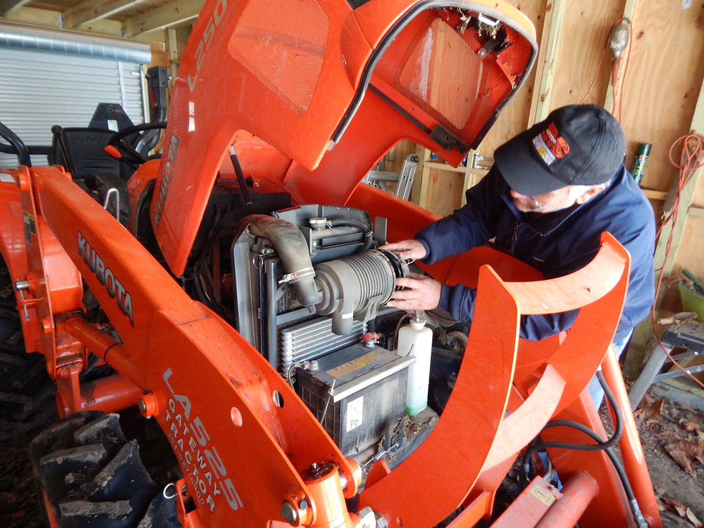 Robert Braswell working on a piece of Kubota equipment