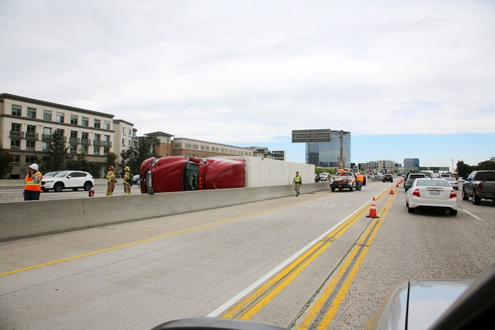 Overturned tractor-trailer on a busy highway