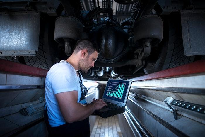 man looking at analytics on laptop