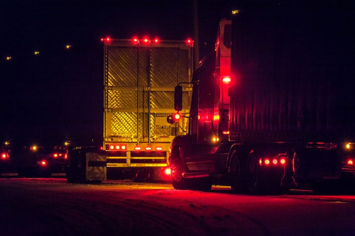 semi trucks in the dark with red led lights glowing