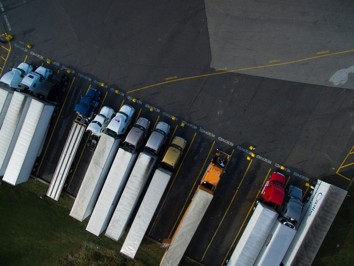 aerial view of parked semi trucks