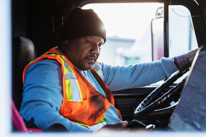 truck driver on his phone
