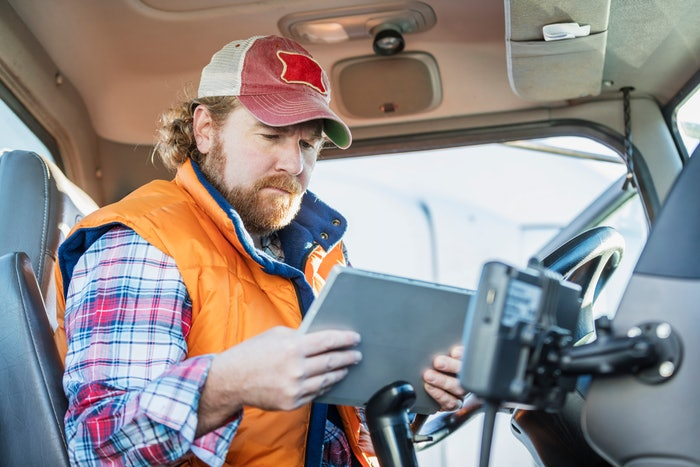 Truck driver using tablet