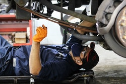 a mechanic conducting an oil change